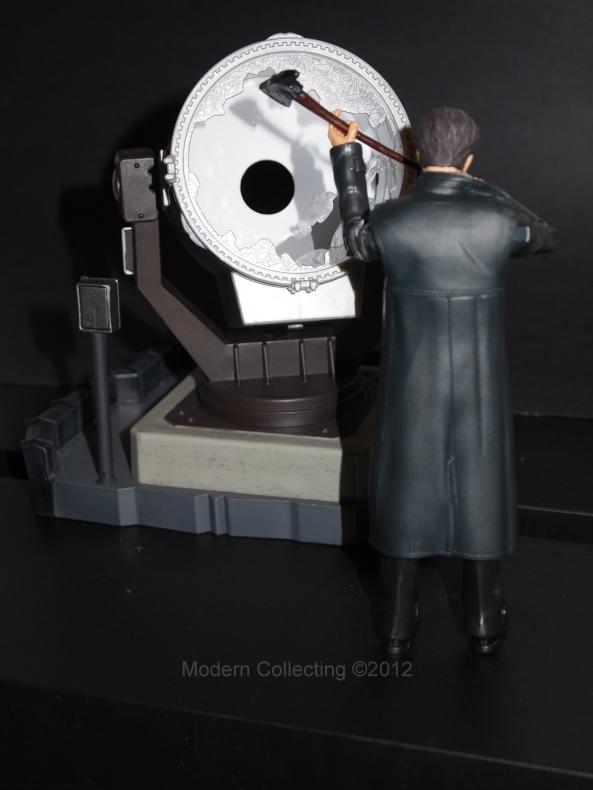 Jim Gordon taking a axe to the Bat-Signal