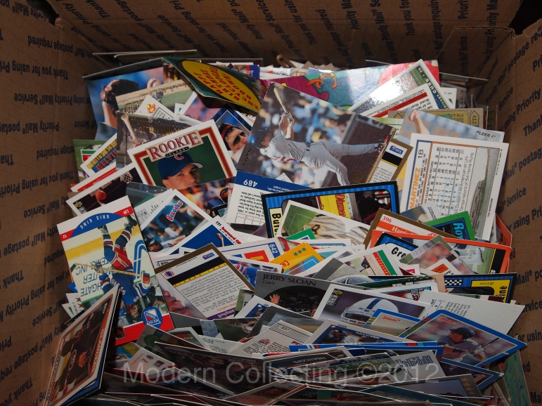 Piles of trading cards in a box