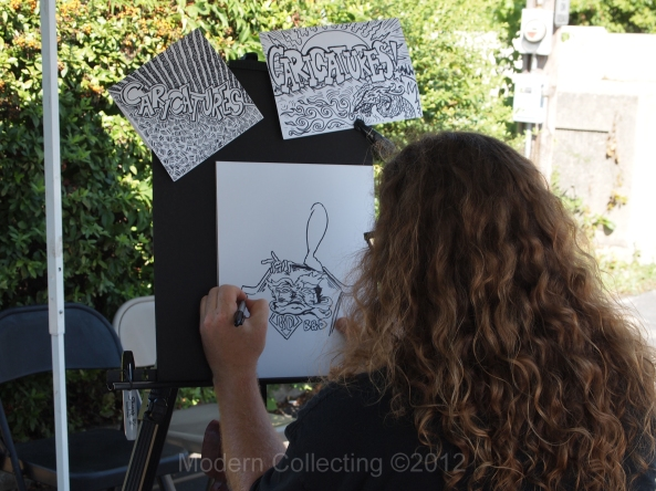 Artist illustrating at B & D Comic Shop 30th anniversary