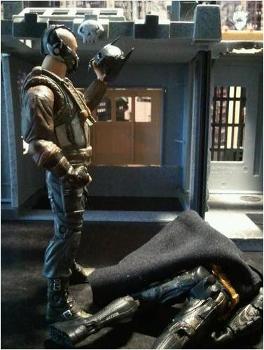 Bane holding Batman cowl